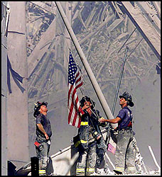 Firefighters raise the flag at WTC